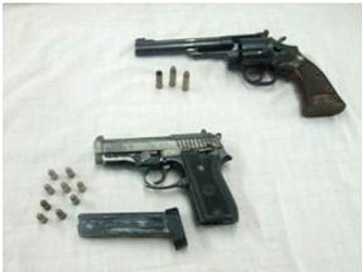 The guns found at the scene (Police photo)