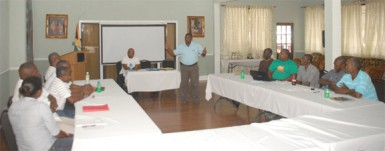 GBOC president Cecil Chin makes a point Saturday at Saturday's Referees seminar held at Duke Lodge.
