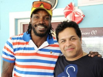 West Indies star Chris Gayle (left) shares the spotlight with managing director of Spartan Sports, Kunal Sharma, during a presentation at Lucas Cricket Club yesterday. (Jamaica Gleaner photo)