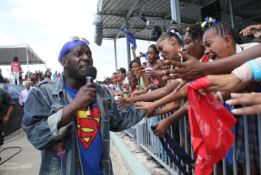 "Austin ""SuperBlue"" Lyons greets his adoring fans at the Junior Soca Monarch competition, Queen's Park Savannah, Port-of-Spain, on Friday. (Trinidad Guardian photo)"