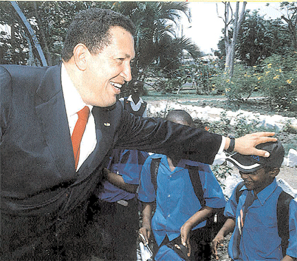 Flashback: Hugh Chavez greeting a schoolchild during his visit to Guyana on February 19, 2004. (Stabroek News file photo)