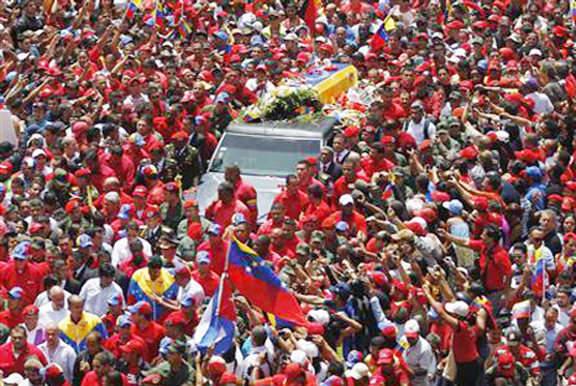 The coffin of Venezuela's late President Hugo Chavez is driven through the streets of Caracas after leaving the military hospital where he died of cancer, in Caracas yesterday. REUTERS/ Carlos Garcia Rawlins