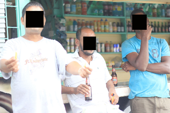 These men were having an afternoon beer at a city spot.