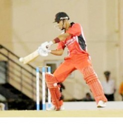 Opener Lendl Simmons ... led T&T's victory with 87.