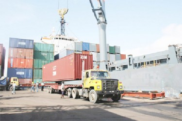 Containers being moved from Port Georgetown