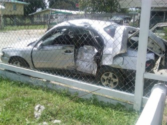 The wreckage of the Toyota Corolla car in which Denzil Thomas and Quincy David sustained fatal injuries. The car was later impounded at the Grove Police Station