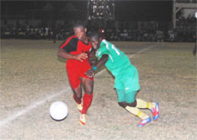 Action in the Mayor's Cup semi-final between Slingerz FC and the Guyana Defence Force.