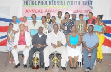The awardees along with the President of the Athletics Association (AAG) Aubrey Hutson (seated left), President of the youth club Pauline Massay and Colin Boyce Deputy Superintendent of the Guyana Police Force/Games Officer after the Police Progressive Youth Club annual awards ceremony on Friday evening at the Police Sports Club Hall.