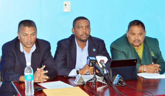 SHOW OF SUPPORT! West Indies Cricket Board president Whycliffe Cameron is flanked by Guyana Cricket Board president Drubahadur and Secretary Anand Sanasie, left. (Orlando Charles photo)