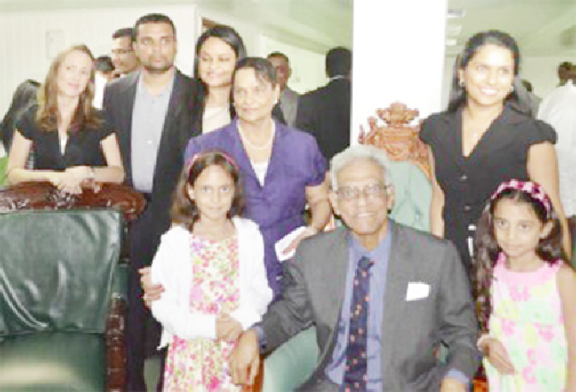 Reepu Daman Persaud (sitting) with his family on the day he was honoured by Parliament. His daughter, Dr Vindhya Persaud who has followed his footsteps by becoming a PPP/C MP is standing third from left. (SN file photo)
