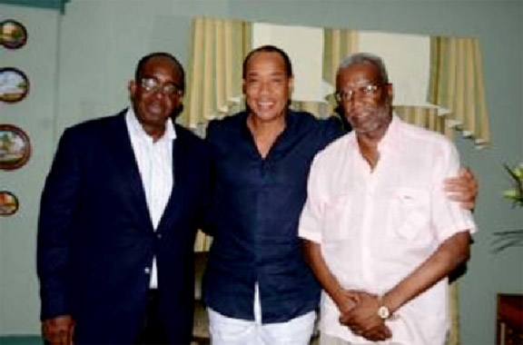 Michael Lee-Chin (centre) flanked by Odinga Lumumba (right) and Patrick Hylton