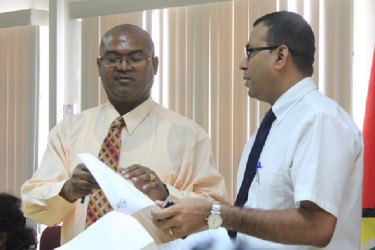 Minister of Natural Resources Robert Persaud (right) and GGMC Acting Commissioner Rickford Vieira at the press conference.