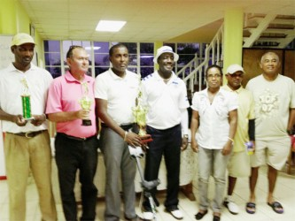 Winner Alfred Mentore (third left), Rev. Dr. Philbert London with other winners and representatives of Beacon Ministries and the LGC.