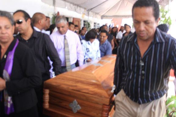 The casket with the remains of Dr Dale Bisnauth being borne out of the Burns Memorial Church yesterday