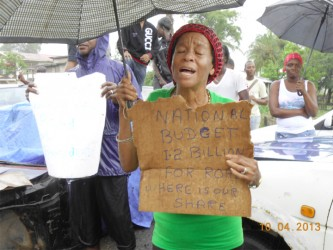 An elderly resident with her placard