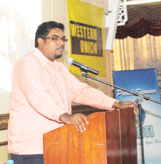 Acting Tourism Industry and Commerce Minister Irfan  Ali addressing a small business forum at the Pegasus Hotel on Wednesday