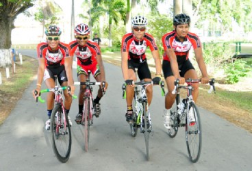 Team Coco's riders Paul DeNobrega, Raynauth Jeffrey, Raul Leal and Christopher Holder pose for a Stabroek Sport photo before training yesterday. (Orlando Charles photo)