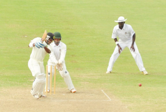 Guyana's Leon Johnson, above played a fighting innings of 70 in an effort to stave off defeat but defending champs Jamaica still managed to secure an outright win in three days at the Providence National Stadium yesterday in the four-day regional encounter. (Orlando Charles photo)
