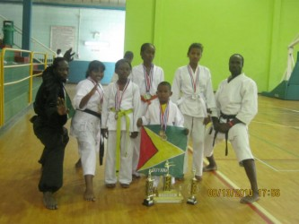 The karatekas with their medals following the championships in Trinidad and Tobago.
