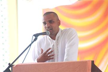 Reepu Daman Persaud's son Vishok speaking at the funeral service yesterday.