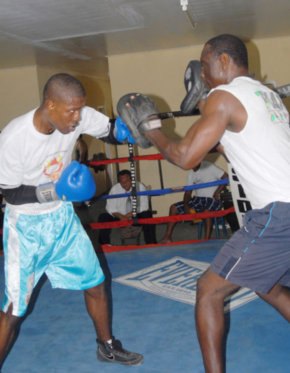 Clive 'The Punisher' Atwell attacking the pads of trainer, Lennox Daniels during a recent workout at the Andrew 'Six Head' Lewis Gym. (Orlando Charles photo)