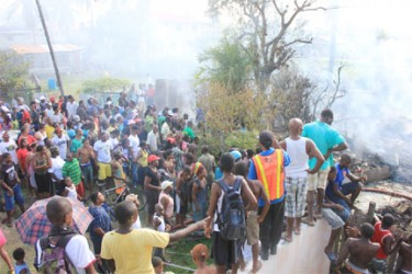 A huge crowd of curious onlookers gathered near the house of Florence Dyer-Tyndall to get a glimpse of the plane that crashed and the damage caused (Photo by Arian Browne)