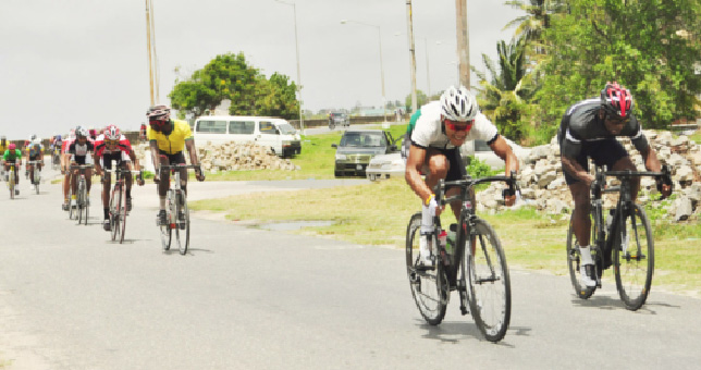 BEAST MODE! National cyclist, Alonzo Greaves (left) in action during one of his three victories yesterday at the Roraima Bikers Club (RBC) and Caribbean International Distributors Inc. inaugural 10-race cycle meet. (Orlando Charles photo)