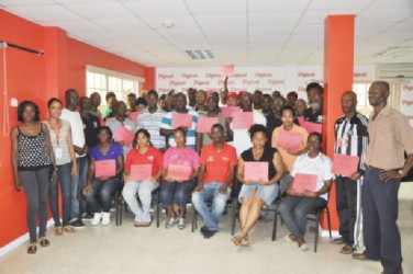Participants with their certificates along with Digicel's representatives last evening at the conclusion of the Digicel's Kickstart workshop.