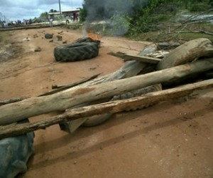 The tyres and logs that were used to block the road