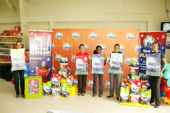 Staffers pose with Breeze products during last Wednesday's launch