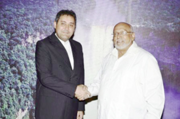 Iranian Ambassador to Guyana Hojattolah Soltani (left) shakes hands with President Donald Ramotar (GINA photo)