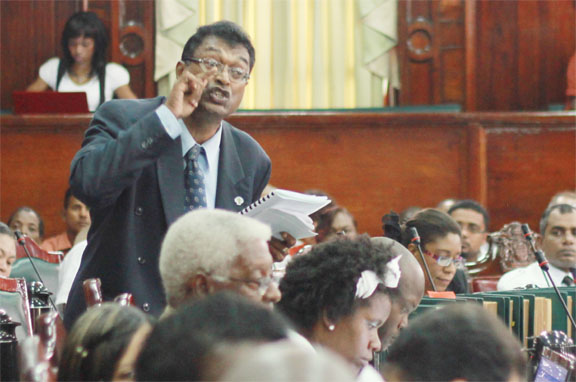 You promised! AFC MP Khemraj Ramjattan reads from the Hansard  yesterday. (Photo by Arian Browne)