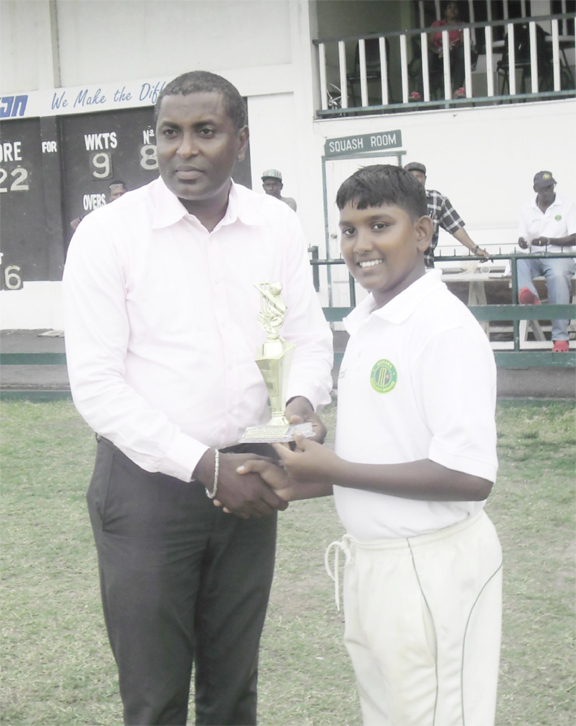Man-of-the-Match Bhaskar Yadram receiving his trophy from GCB vice-president, Alfred Mentore.