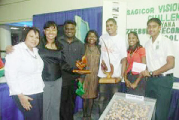 From left: Marlene Chin, Communications Manager at Sagicor; Petal Punalall-Jetoo, National Science Coordinator; Alan Bhajan, District Education Officer  Region 3; Jennifer Cumberbatch, Director of NCERD; Dhanraj Rambarose, Lead Teacher at Zeeburg Secondary; Vidya Ram, Science Teacher at Zeeburg Secondary; and Lakshman Ramdat, Leader of the Zeeburg Secondary team.