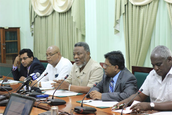 Prime Minister Sam Hinds (centre) speaking at a press conference yesterday at Parliament on the decision by Speaker Raphael Trotman in favour of the opposition on the question of cuts to the budget. Also in photo from left are Attorney General Anil Nandlall, Minister in the Ministry of Finance Juan Edghill, Finance Minister Dr  Ashni Singh and Works Minister, Robeson Benn.