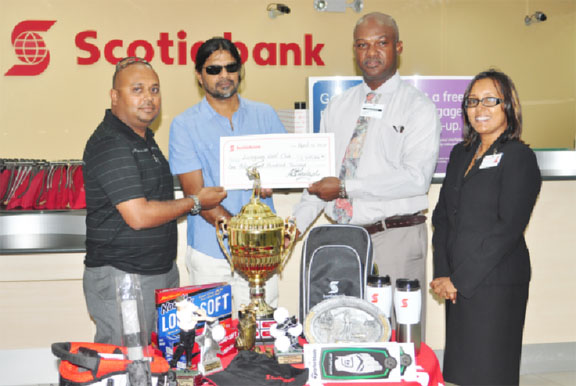 Scotiabank's manager, Brian Hackett, second from right, hands over the sponsorship cheque to David Mohammed of the Lusignan Golf Club in the presence of Yog Mahadeo and Jennifer Cipriani-Nelson.