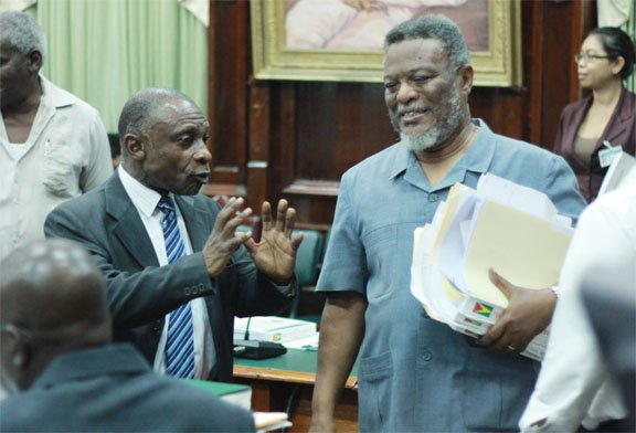 Prime Minister Sam Hinds (right) and APNU MP Carl Greenidge in an exchange yesterday. (Arian Browne photo)