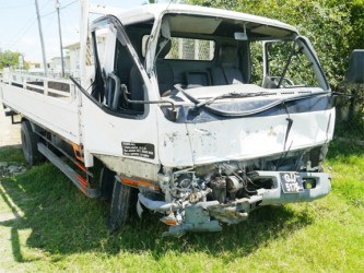The damaged Canter truck