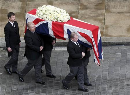 The coffin of former British prime minister Margaret Thatcher is carried from the Chapel of St Mary Undercroft in the Palace of Westminster to a hearse, as it makes its way to St Paul's Cathedral for her funeral service, in London April 17, 2013. Reuters/Steve Parsons/Pool
