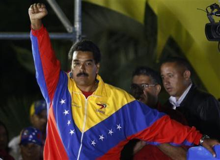 Venezuelan presidential candidate Nicolas Maduro celebrates after the official results gave him a victory in the balloting, in Caracas April 14, 2013. REUTERS/Tomas Bravo