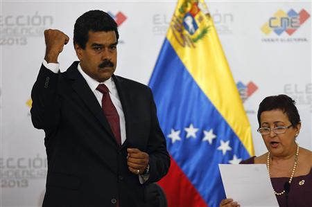 Venezuela's President-elect Nicolas Maduro gestures as Tibisay Lucena, president of the National Electoral Council (CNE), reads a certificate confirming him as winner of Sunday's election, in Caracas, April 15, 2013. Credit: Reuters/Carlos Garcia Rawlins