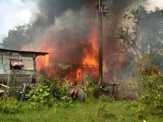 The house on fire after the plane crashed into it.