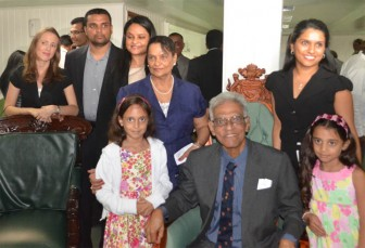 Reepu Daman Persaud (sitting) with his family on the day he was honoured by Parliament. His daughter, Dr Vindhya Persaud who has followed his footsteps by becoming a PPP/C MP is standing second from left.