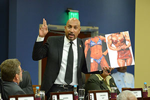 Sport Minister Anil Roberts displays a photo of two female bodybuilders during his presentation of the Anti-Doping in Sport Bill at yesterday's sitting of the Lower House in Port of Spain. (Trinidad Express photo)