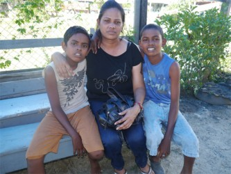 Jeanette Hookumchand and her two sons; Jonathan (at right) and Cliston