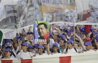 People carry a poster of late Venezuelan leader Hugo Chavez during the Mayday parade in Havana's Revolution Square May 1, 2013.  (Reuters/Desmond Boylan)