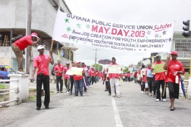 The contingent from the Guyana Public Service Union marches along Albert Street yesterday, heading for the Critchlow Labour College where the GTUC May Day Rally was held. (Photo by Arian Browne)