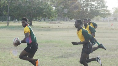 National star player, Claudius Butts evades opposition in yesterday's national trials.