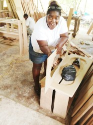 One of the participants in the La Grange, Nismes and Bagotsville empowerment project being taught the finer points of carpentry.