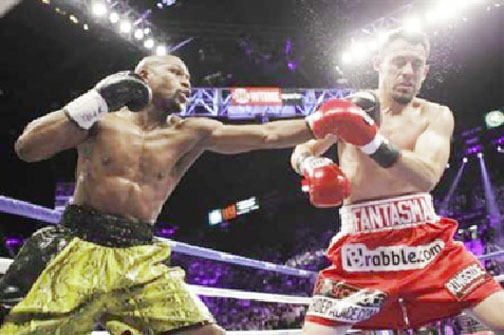 WBC welterweight champion Floyd Mayweather Jr. (L) of the U.S. connects a punch on Robert Guerrero, also of the U.S., during their title fight at the MGM Grand Garden Arena in Las Vegas, Nevada  on Saturday. REUTERS/Steve Marcus